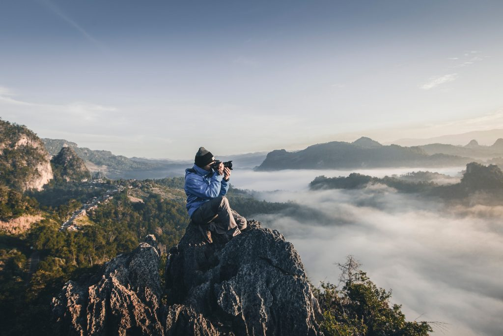 guy holding camera on a mountain